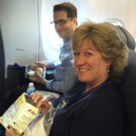 Associate Creative Director, Charlie Worcester, enjoys his first class seat alongside Alaska Air Cargo's Shannon Stevens.